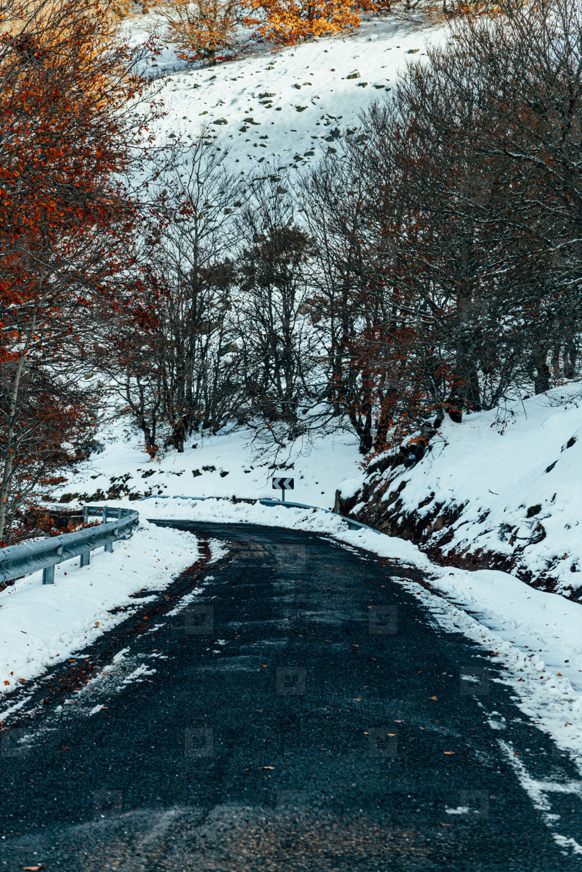 Snowy mountain road at sunrise in spain