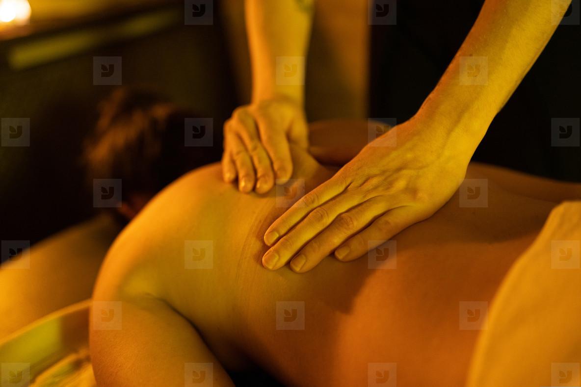 Woman receiving back massage in Arab Baths