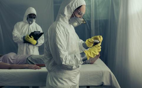 Doctors preparing medication for sick woman