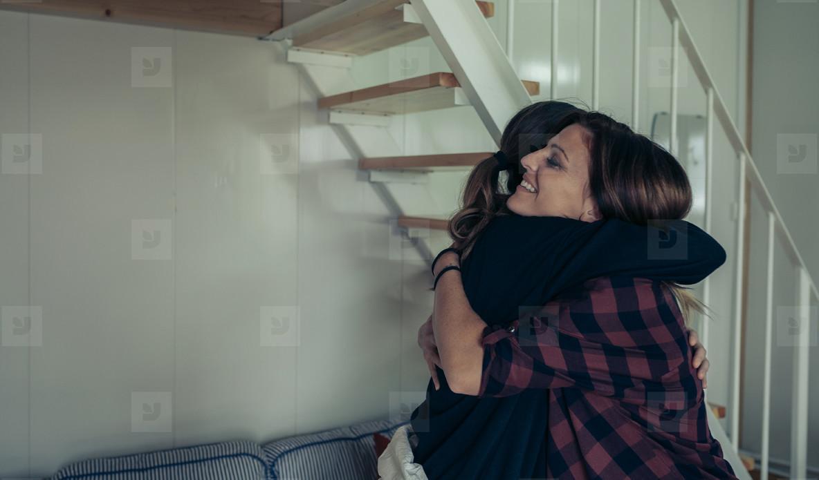 Happy woman hugging her friend