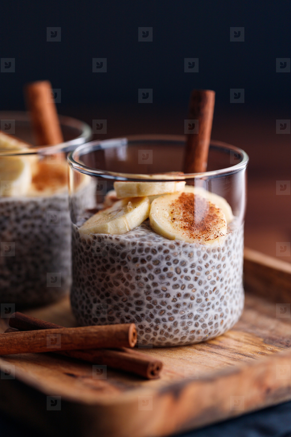 Chia pudding with coconut milk and banana in glasses on a table  Vegetarian healthy dessert