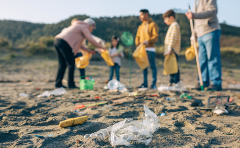 Plastics in the beach with group of volunteers
