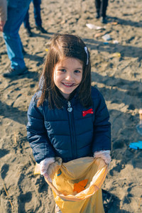 Girl showing garbage collected from the beach