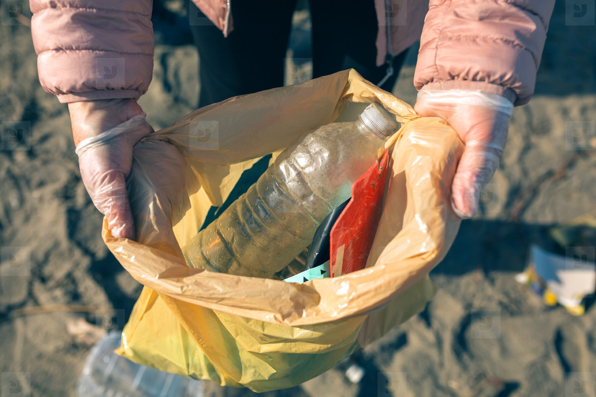 Woman showing garbage collected from the beach