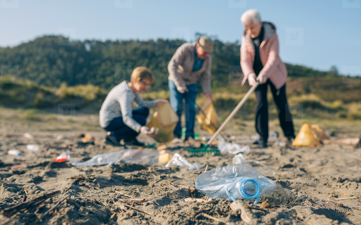 Senior volunteers cleaning the beach