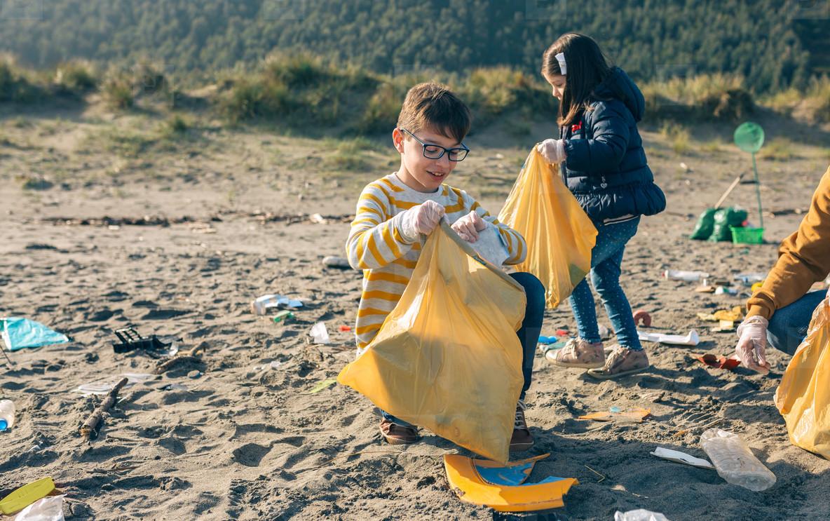 Children volunteers cleaning the beach