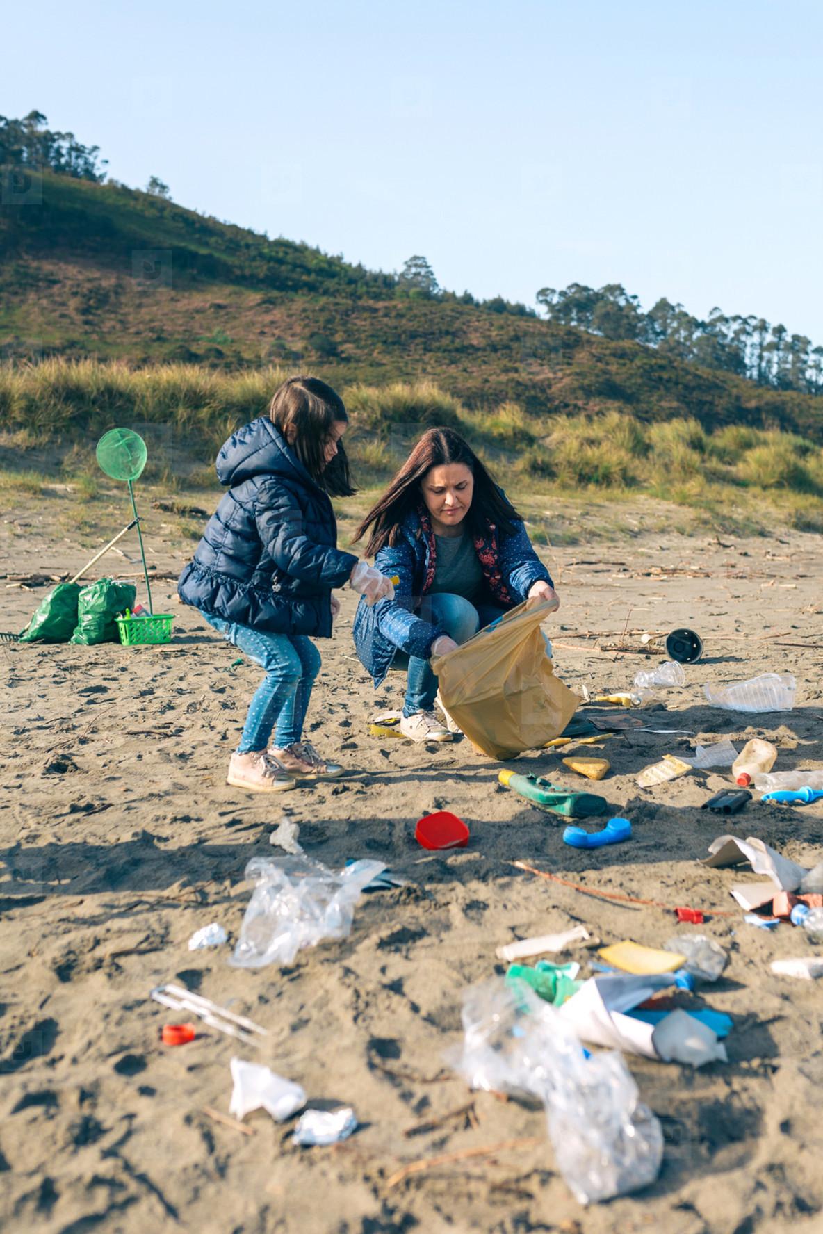 Female volunteers cleaning the beach