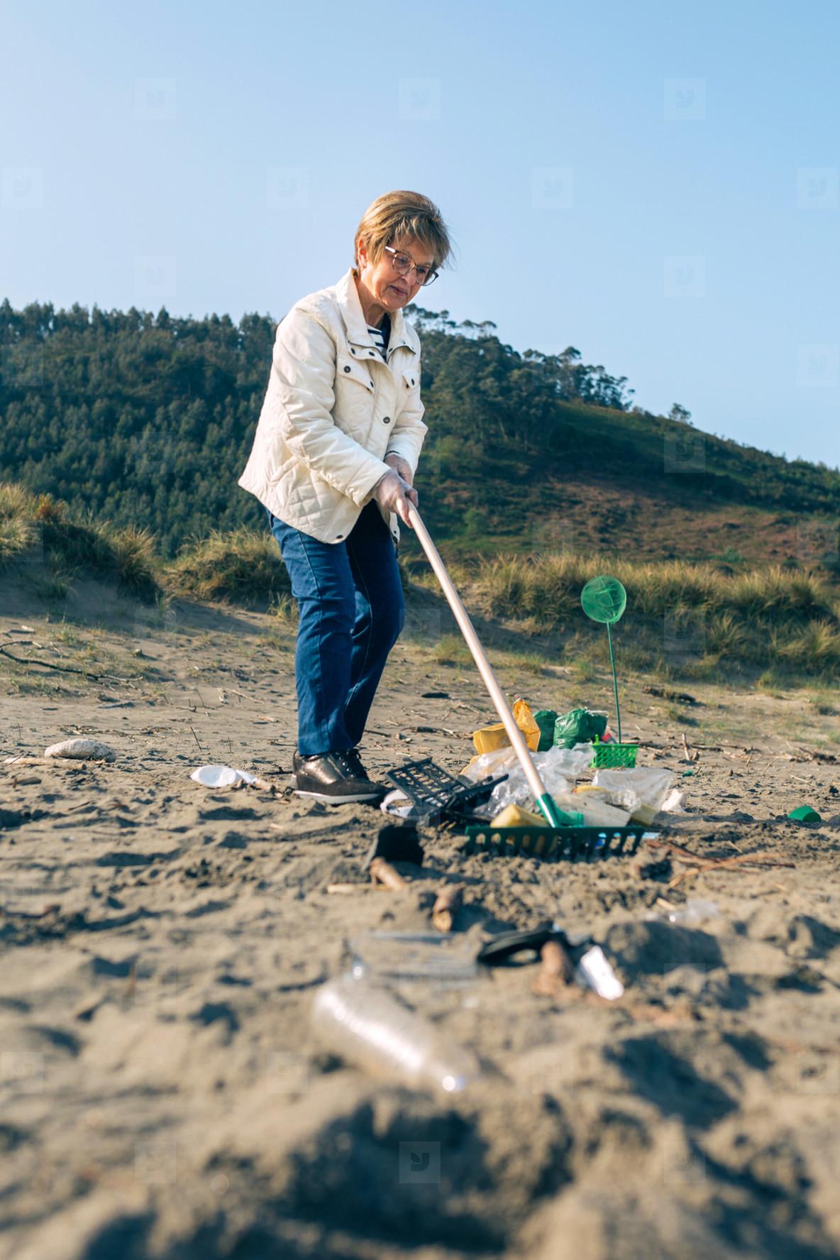Female volunteer cleaning the beach