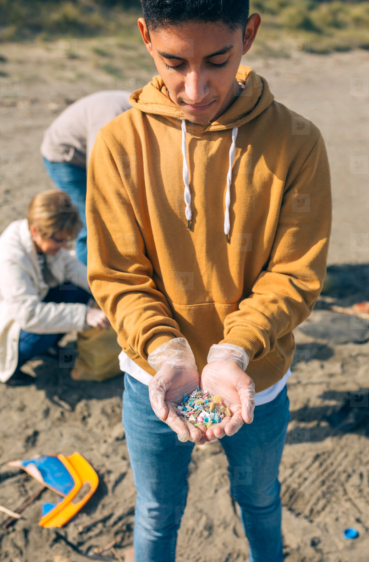 Young man showing microplastics