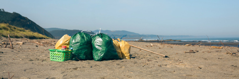 Garbage bags and utensils on the beach