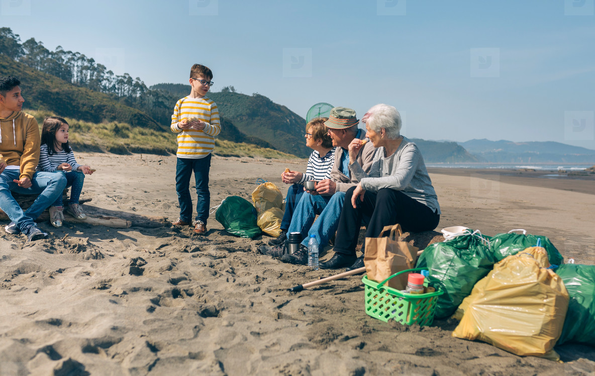 Volunteers resting after cleaning the beach
