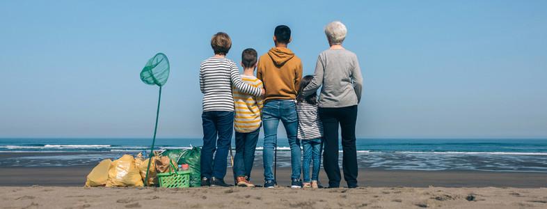 Volunteers backwards watching the sea