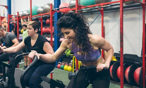 Sportswomen doing air bike indoor