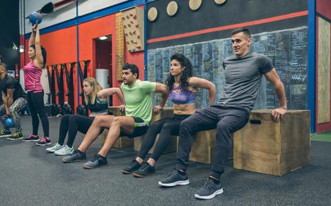 Athletes exercising doing box squats