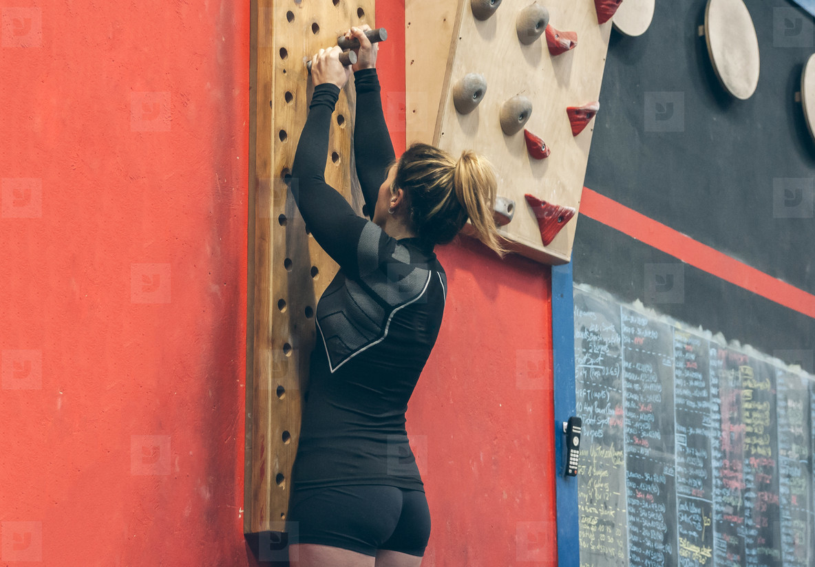Woman hanging on the pegboard