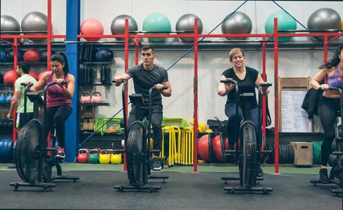 Athletes doing air bike indoor