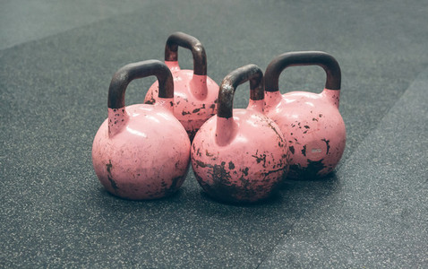 Kettlebells on the floor of a gym