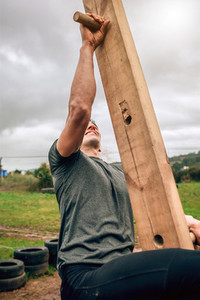 Participant in a obstacle course doing pegboard