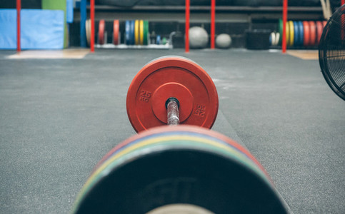 Barbell with weights in a gym