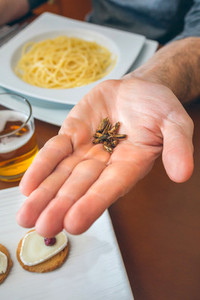 Man showing a handful of crickets