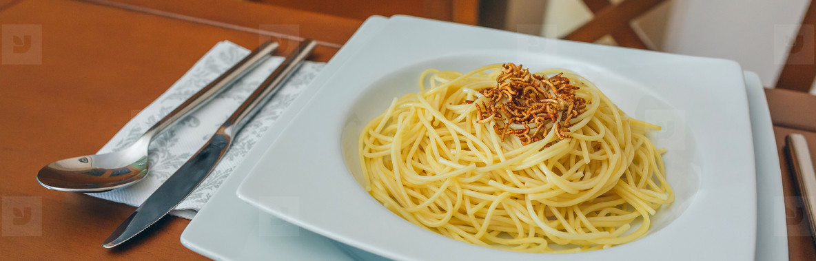 Spaghetti with worms dish