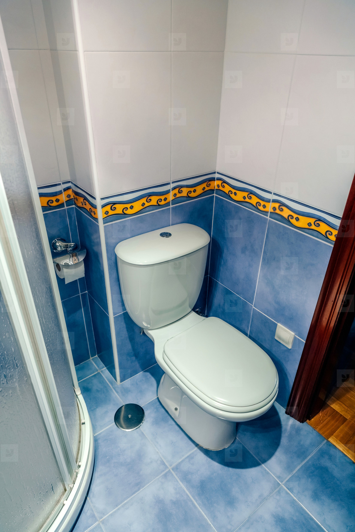 Small bathroom with toilet and shower screen