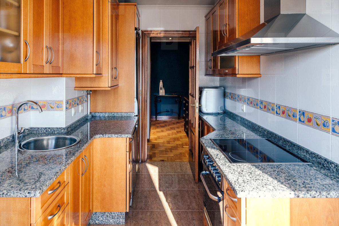 Kitchen on two fronts with wooden furniture
