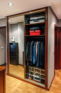 Built in wardrobe open with mirror doors