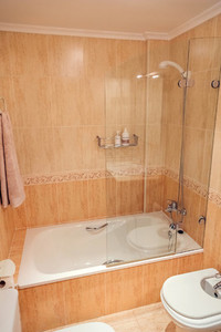 Bathroom with bathtub and shower screen