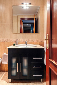 Bathroom with washbasin cabinet and mirror
