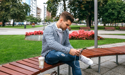 Young man using tablet outdoors