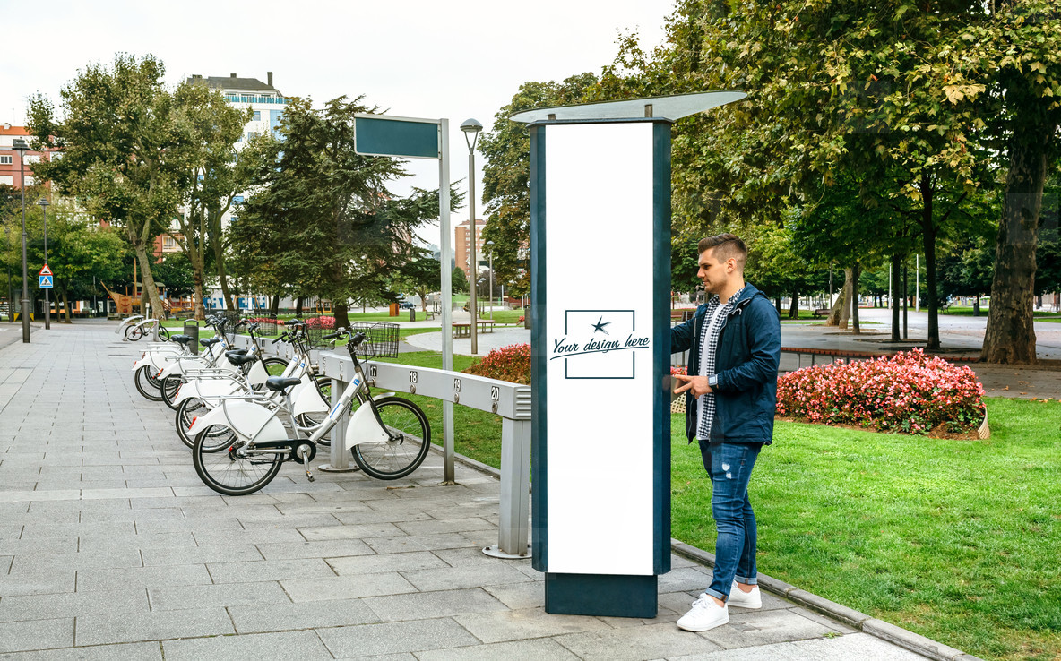 Man renting bicycle in a customizable post
