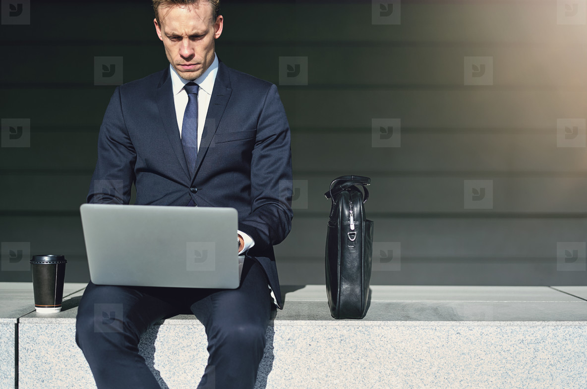 Confident businessman while work with his laptop