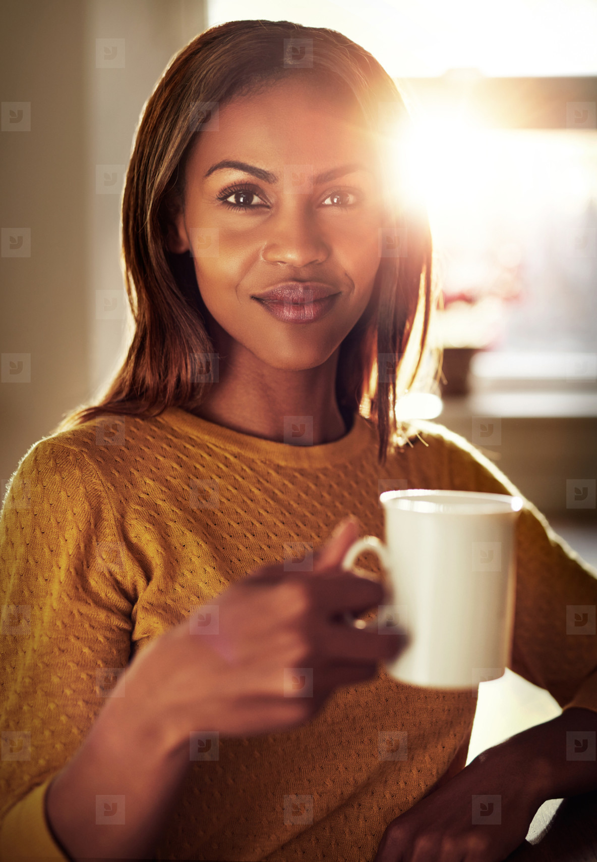 Attractive young woman enjoying a cup of coffee