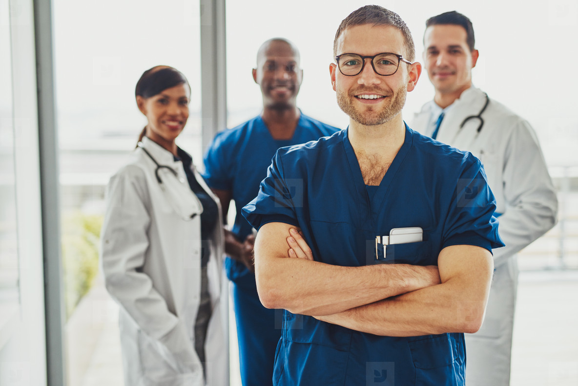 Confident doctor in front of group