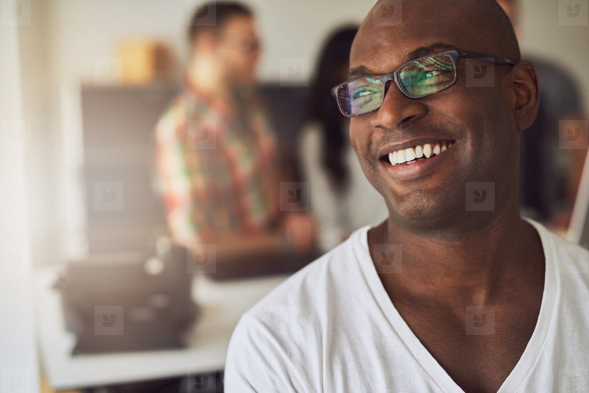 Close up of smiling worker in white shirt