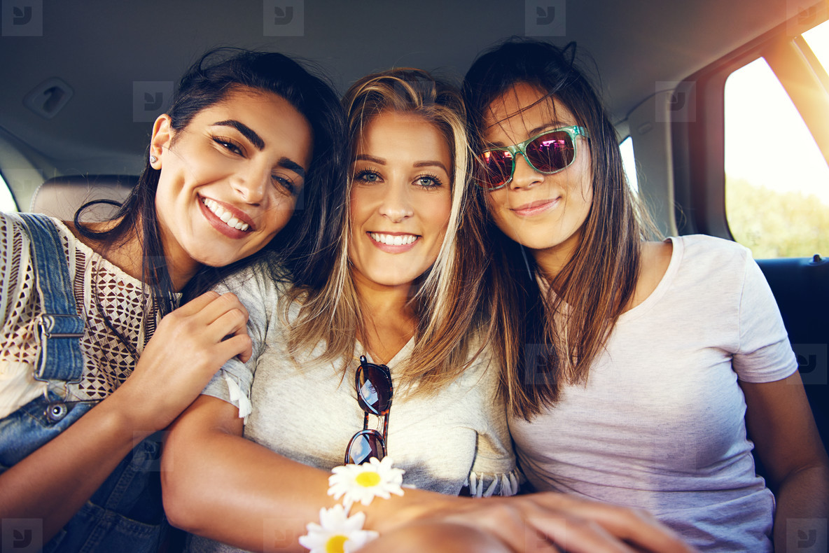 Three beautiful multiracial young women friends