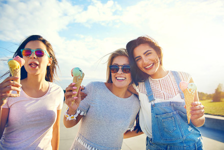 Three girlfriends enjoying a summer treat