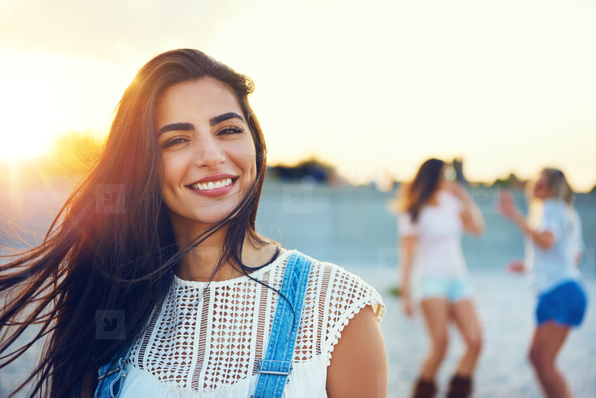 Smiling woman with pair of dancing friends