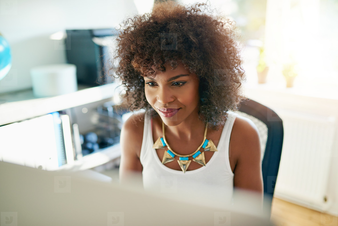 Attractive young woman working on a computer