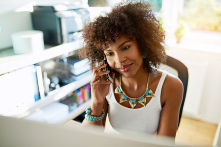 Attractive businesswoman chatting on a mobile