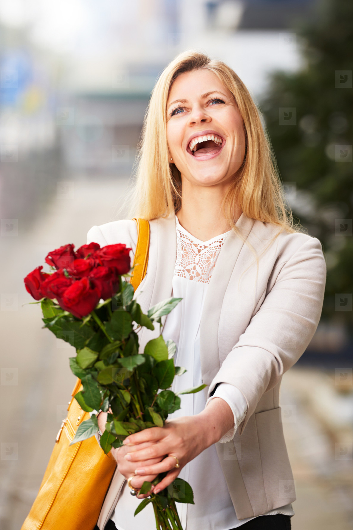 Professional woman with head tilted holding roses