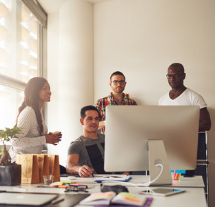 Group of young adults at small business