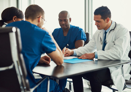 Young people on medical staff meeting