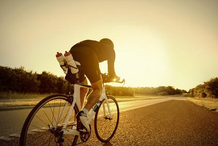Sportsman riding a professional bike on road