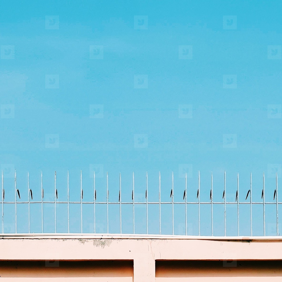 Top of a metal fence against sky