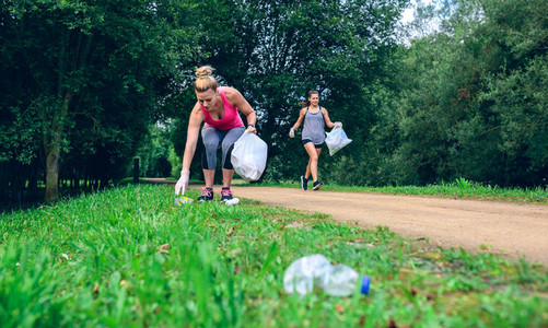 Two girls doing plogging