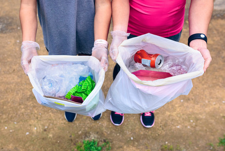 Plogging  Girls showing garbage
