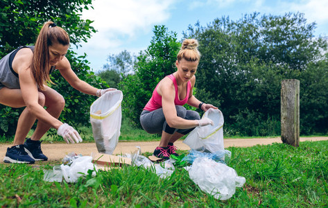 Girls with garbage bag doing plogging