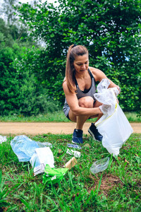 Girl with garbage bag doing plogging